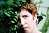 Dark Garden (Geekgirly) Tags: woman green girl garden flora nikon florida miami january 85mm saturday redhead storypeople d300 2016 darkgarden geekgirly wwwgeekgirlyca