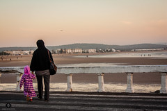 CROSSING ROADS (Daniele Catucci Photos) Tags: ocean africa road street family sunset sea sky woman baby love colors children landscape crossing child mother culture streetphotography marocco spiaggia essaouira