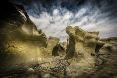 MIRANDO AL CIELO (Mauro Esains) Tags: patagonia mar cielo nubes aire libre piedras restinga océano surrealista