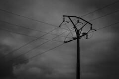 high voltage (Adams Guijarro Ortiz) Tags: sky white black blancoynegro blanco canon nikon exterior y sony negro paisaje dia bn cielo nubes nublado electricidad fotografia tension estenopeica voltage bodegon lineas direccion photographi