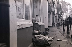 Street Life (4foot2) Tags: street blackandwhite bw dog money film monochrome 35mm mono tea homeless grain fsu streetphotography streetlife ilfordhp5 35mmfilm soviet hp5 streetphoto jupiter12 hastings analogue kiev ilford  ussr reportage filmgrain streetshot reportagephotography kiev4 russiancamera 2016 filmphotography pgtips streetdog russianlens formersovietunion  4 12 teanol 4foot2 4foot2flickr 4foot2photostream fourfoottwo teanolc