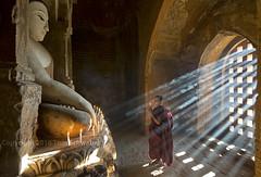 Enlightenment (pdxsafariguy) Tags: travel boy statue standing temple asia southeastasia candle robe buddha burma religion praying young monk buddhism myanmar spirituality sunbeam bagan novice tomschwabel