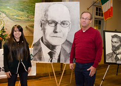 Artist Jocelyn McDonald with Mike Moran and portrait of Moran's great grandfather Luke Dillon