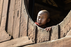 Am I missing something? (luca.onnis) Tags: wood photography one kid monk myanmar bold lookingback lookingoutthewindow nyaungshwe lucaonnis