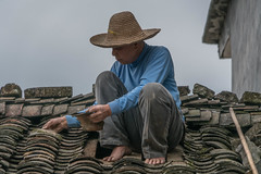 roofer.jpg (Photos4Health) Tags: china old travel sunset shadow man male guy ecology sunrise dark person li asia village place guilin yangshuo hill chinese elderly fisher stick tradition guizhou villager guangxi ecotourism xingping