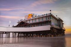 Daytona beach pier during the sunrise (tshabazzphotography) Tags: sunrise canon pier motionblur waterblur daytonabeach dslr atlanticocean longshutterspeed beachlover beachlandscape flickrshoot longexposurephotography floridalife canont5i canonoffical