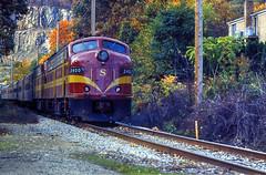 New York, Susquehanna & Western E9A 2400, Pompton Lakes (1 of 3) (gg1electrice60) Tags: county railroad ny newyork train river sussex newjersey gm nj row autumnleaves butler rails upstatenewyork newyorkstate orangecounty warwick locomotives coveredwagon threerivers rightofway dieselengine generalmotors 3rivers railroadtrack passengertrain morriscounty emd sussexcounty diesellocomotive pomptonlakes fantrip e9a orangecountyny passaiccounty nysw electromotivedivision classicdiesel ramaporiver franklinnj butlernj sussexcountynj pequannockriver wanaqueriver orangecty maroonyellow eunits restoredlocomotives pomptonlakesnj pomptonfalls pomptonjunction passengerlocomotive cabunits railfantrip newyorksusquehannawesternrr newyorksusquehannawesternrailroad maroonandyellow fallexcursion stockholmnj firstgenerationdiesel nysw2400 nyswe9anumber2402 nyswe9ano2402 colorfulfallleafexcursion restoreddieselengines biardsfarm newyorksusquehannandwestern nysandwno2400 nysw2402 nysandw downtownpomptonlakes pomptonlksnewjersey nyswe9anumber240 stockhelmnj