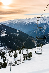 No Passengers yet (Fabian F_) Tags: morning winter vacation sky orange white mountain snow ski clouds forest sunrise easter austria sterreich lift himmel wolken berge passenger wald zillertal piste sessellift weis diesig