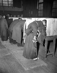 A Japanese woman carries her son on her back as she marks her ballot in Tokyo on April 10, 1946, their first free election in generations. Japanese women exercised the right to vote for the first time to elect a new lower house in the diet (House of Repre (Histolines) Tags: she new woman house history japanese for tokyo back women election time 10 free first son right her retro marks ap april timeline lower their diet generations vote carries ballot elect 3003 1946 representatives  2323 vinatage a exercised historyporn histolines photocpg httpifttt1uoavfc