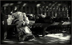 Sleeping rough (* RICHARD M (5 million views)) Tags: poverty street sleeping bench sadness mono blackwhite shadows sad candid plasticbag asleep moderntimes southport vagrant sleeper oblivious shoppingbag deprivation itinerant lostsoul merseyside downandout 21stcentury homelessness sefton hardtimes homelessman lightandshade sleepingrough heartrending bythewayside austerity downonhisluck roughsleeping roughsleeper asignofthetimes outforthecount nofixedabode asleeponbench southportslordstreet 21stcenturybritain 21stcenturyengland