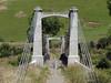 Old suspension bridge (Home Land & Sea) Tags: road newzealand rural nz disused napier pointshoot 1925 sonycybershot onelanebridge taihape rangitikeiriver sooc historicplacestrust homelandsea dschx100v springvalesuspensionbridge