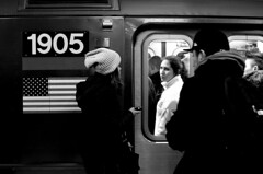 The 'I'm Too Tired To See a Big Lens Pointed at Me' Look (sjnnyny) Tags: nyc monochrome underground downtown crowd transit lookingback riders 7line nylife notcandid stevenj subwayrider sjnnyny