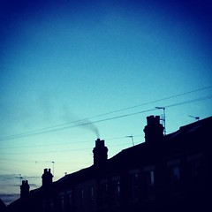 Chimney smoke over Hanwell (moley75) Tags: chimney london square dusk smoke bluesky squareformat telephonewires oldfashioned hanwell iphoneography instagramapp xproii uploaded:by=instagram