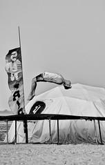 DSC_4755 (klakeduker) Tags: sea summer man jumping sand legs head flag flight trampoline tent genre coup