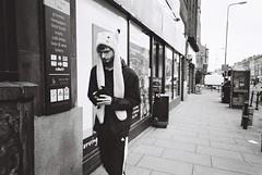 Pikachu (akio.takemoto) Tags: street people blackandwhite film hat scotland blackwhite edinburgh strada streetphotography delta persone pikachu leith edimburgo ilford pointshoot biancoenero cappello scozia leithwalk 3200iso pellicola ricohgr1 analogicphotography fotografiaanalogica