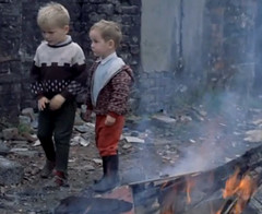 Any more to burn (theirhistory) Tags: uk boy england cinema film fire kid shoes child kinderen burning jacket trousers wellies rubberboots newsreel
