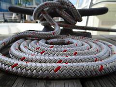 Docked (Quik Snapshot) Tags: wood red macro closeup marina harbor boat dock marine sony rope docked boatcleat hx200v dschx200v