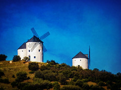 Windmills of La Mancha (Colormaniac too) Tags: travel blue sky texture beautiful landscape photography la spain colorful windmills collection nik filters iconic mancha flypaper