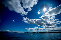 Cloudy day  (T.ye) Tags: blue sky cloud sun monochrome clouds river landscape boat angle cloudy wide