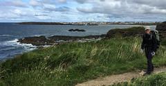 Julie hiking away from Portrush (brookscl) Tags: ireland unitedkingdom northernireland portrush ccwday3map