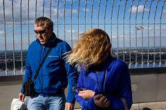 . (www.piotrowskipawel.pl) Tags: city people woman man tower germany mnchen bayern wind streetphotography tourists hairs decisivemoment olympiaturm olympiapark colorstreetphotography pawepiotrowski piotrowskipawelpl