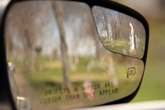 Car Mirror 3 (Sarah Hina) Tags: cemetery reflections rearviewmirror lookingback carmirror virginmarystatue