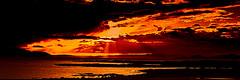 Sunset North of Arran (Brian Travelling) Tags: sunset orange sun sunlight reflection water reflections island fire reflecting bay scotland riverclyde scenery sundown pentax vibrant scenic peaceful reflect soe arran isleofarran beams sunbeams contemplation firey ayrshire firthofclyde northayrshire westcoastofscotland westofscotland isleofgreatcumbrae sunsetsandsilhouettes pentaxkr