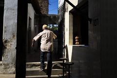 By the alleys/Pelos becos (Raoni Coriolano) Tags: man contrast way alley gate shadows walk porto streetphotography photojournalism feira mercado cear contraste homem sombras nordeste beco comercio serto idoso documental fotojornalismo freemarket 2015 raoni oldbuild crates canon6d coriolano sigmaart