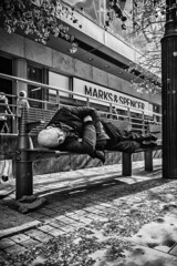 Not a park bench but it will do (tootdood) Tags: park street sleeping blackandwhite bench manchester nap market sleep snooze napping fromthehip streetcandid canon70d