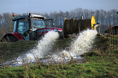Floodwater being  pumped from a field near Linstock, 13 January 16 (gillean55) Tags: camera bridge tractor field canon river north powershot cumbria eden carlisle hs drainage pumping superzoom masseyferguson linstock sx50