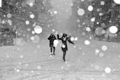 Walking with Jason (jeffreyjune16) Tags: street nyc urban blackandwhite bw snow newyork jason monochrome fashion happy blizzard flatiron visibility
