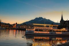 lake Lucerne (dtapkir) Tags: city blue sunset sky mountains color water boats lights switzerland evening aqua ship d750 serene 2470 nikond750