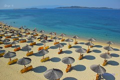 Umbrellas on the Beach Chalkidiki (Halkidiki) Greece (George @) Tags: street travel blue sea summer vacation people beach umbrella island greek george holidays tourists greece welcome umbrellas sunbathing deckchairs bask chalkidiki halkidiki sunbeds          ekdromes