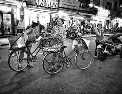 Ho Chi Minh through my lens (Faisal Aljunied) Tags: blackandwhite monochrome bicycle vietnamese candid streetphotography vietnam motorcycle saigon streetvendor hochiminh olympusomdem1 olympus1240mm faisalaljunied