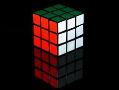 Rubiks Cube (acmelucky777 (so busy right now...)) Tags: life white black reflection germany deutschland stillleben still fotografie dof bokeh cube nrw reflexion spiegelung schwarz wrfel rubiks rubik reflektion jahre schrfentiefe westfalen nordrhein 2016 inszenierung tiefenschrfe alsdorf ern zauberwrfel inszenierte 1980er rubiks p1190374