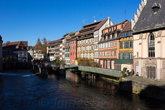 Strasbourg 11 Nov 2015 (JamesPDeans) Tags: windows sun france reflection mill weather architecture buildings river landscape europe commerce power sunny bluesky canals strasbourg alsace locks mills halftimbered waterpower colourfulbuildings allsace crowsteppedgables