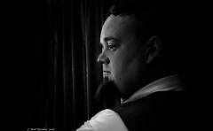 The Nightwatchman. (Neil. Moralee) Tags: portrait blackandwhite bw white man black art monochrome face shirt night dark hair beard mono interesting nikon close artistic zoom character watch neil mature coolpix collar facial nightwatchman darkbackground p7000 18300mm moralee wachman neilmoralee