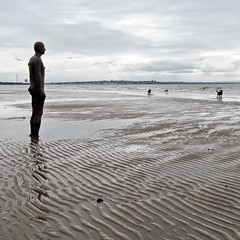 Another Place (Hilary Causer) Tags: uk greatbritain sea england sky sculpture men beach weather standing march sand overcast coastal installation northeast greyday crosby dogwalking antonygormley dullday anotherplace