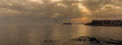 Silence is golden (Enrico Cusinatti) Tags: sunset sea italy beach clouds italia tramonto nuvole mare genoa genova rays raggidelsole enricocusinatti