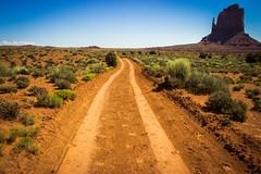 The long and winding road (John_Thomas_) Tags: road monument long desert horizon tracks dirt valley winding