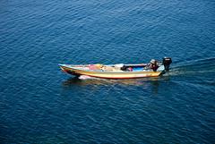 colorful boat (Tom Anirae) Tags: lake color titicaca boat fisherman bolivia trail