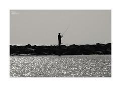 Islas inundadas... (ngel mateo) Tags: sea sky blackandwhite blancoynegro pier mar fishing fisherman spain cielo almera pescador almerimar pescar fishingrod elejido espign caadepescar ngelmartnmateo ngelmateo