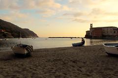 A quiet corner in my town ... (Augusta Onida) Tags: sunset sea italy beach boat barca italia tramonto mare liguria silence spiaggia pescatore silenzio baiadelsilenzio sestrilevante sailorman