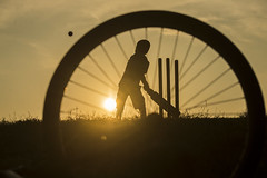 Hit (Photosightfaces) Tags: boy playing game wheel silhouette ball kid hit spokes cricket sri lanka srilanka batting srilankan wickets hitting lankan cricketer