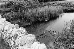 Quiet Man Bridge 03 (Ian Atrus Gazzotti  iangazzotti.com) Tags: bridge ireland blackandwhite bw water rock stone analog 35mm river nikon bn connemara biancoenero irlanda nikonf70 f70 oughterard quietman glengowla