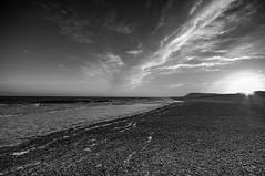 Covehithe Beach Black and White (kevbphotography) Tags: uk sea orange white black beach water reflections coast suffolk sand colours tide east coastal sunet anglia covehithe
