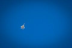 An F-15 Eagle flies high overhead in Tucson, Arizona.