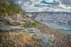 Endless Wall in Winter (reflectioninapool) Tags: trees winter light sky panorama orange white snow mountains color nature water weather stone pine clouds forest river landscape outdoors high woods rocks day westvirginia valley gorge overlook rectangle appalachia newriver endlesswall