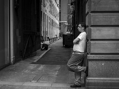 Lunch Break (Leanne Boulton) Tags: life street city uk light shadow portrait people urban blackandwhite bw white man black detail male texture monochrome face lines composition canon mono scotland living blackwhite alley break natural humanity outdoor expression glasgow candid culture streetphotography angles scene human chef alleyway shade 7d posture society leaning depth tone facial candidstreetphotography