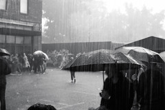Havy Rain (Ser_J) Tags: street city light summer people blackandwhite bw art film monochrome rain composition analog 35mm canon photography photo day photographer moscow streetphotography analogue 135 ilford film35mm     photofilm 35film